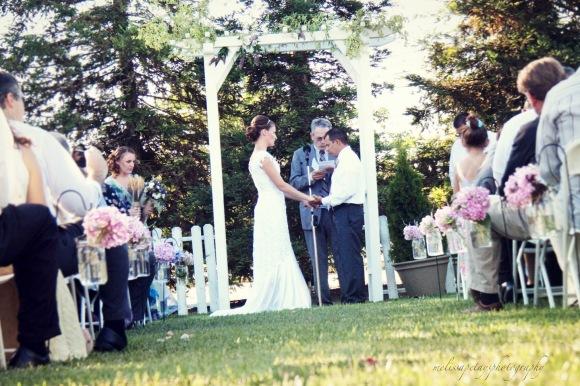 'wedding under arch'