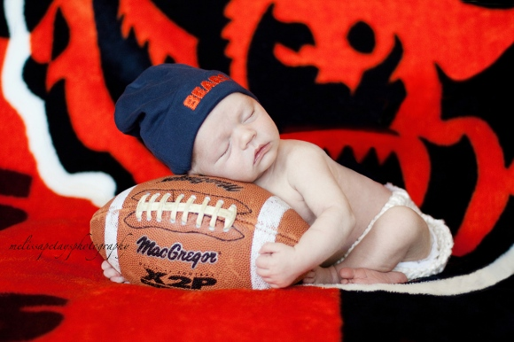 """baby holding football image"""
