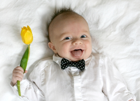 """baby holding flowers picture"""